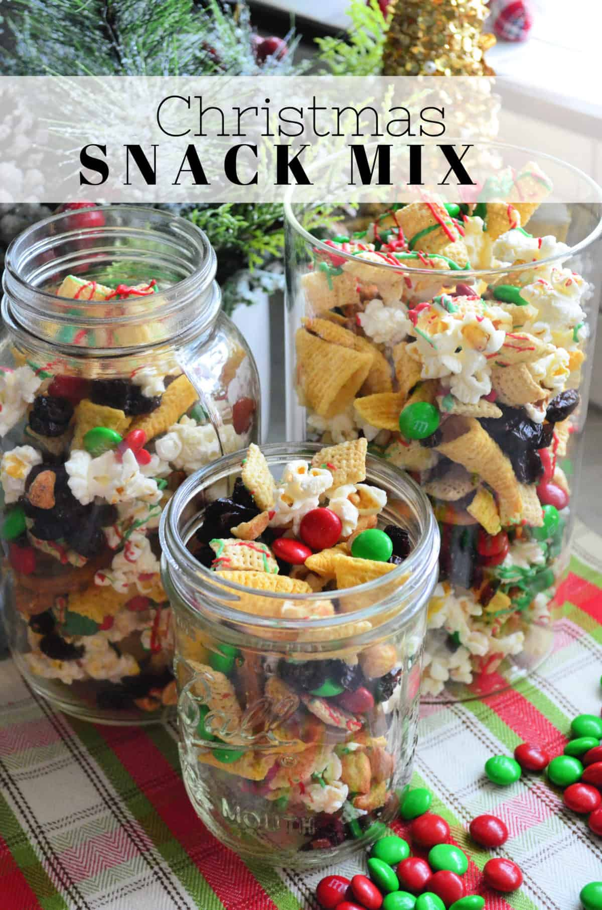 3 class containers of red and green chocolate drizzled check mix and popcorn with title text.