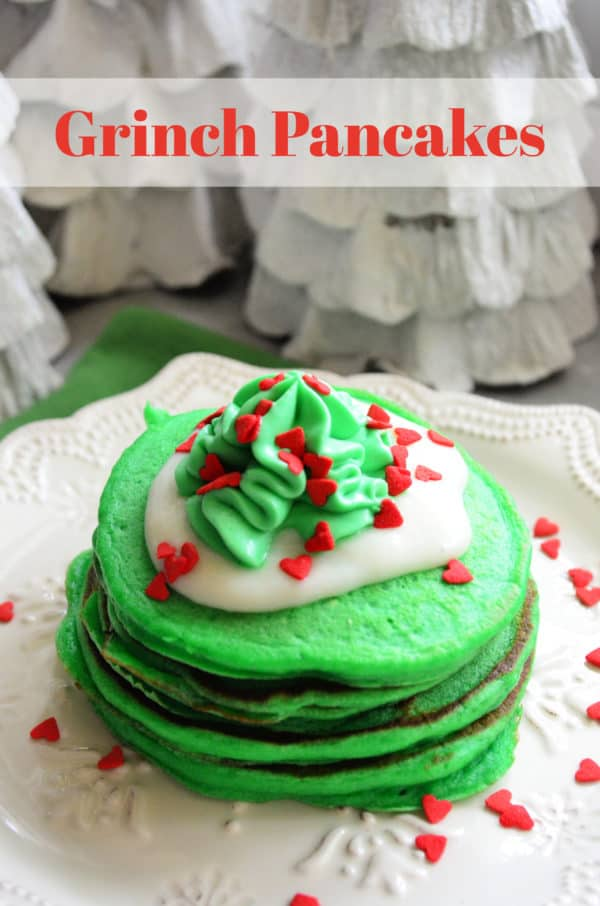 Plated Grinch Pancakes with pinterest title text.