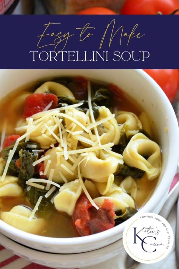 Top view of a white bowl filled with spinach, tomatoes, and tortellini soup with text on image for Pinterest.