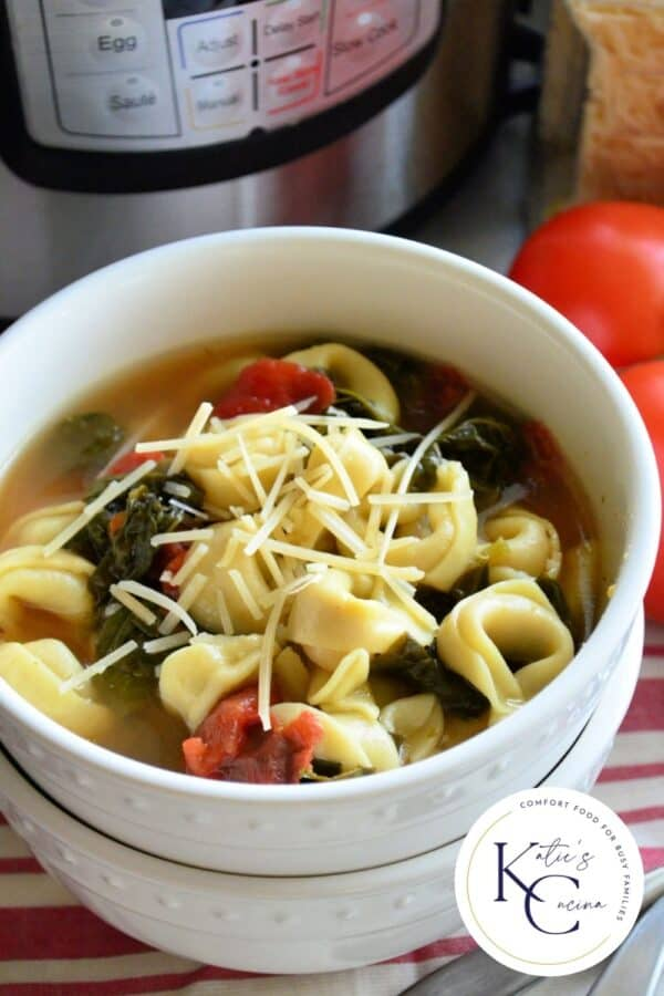 Two white bowls stacked with Tortellini Soup with logo on right corner for Pinterest.