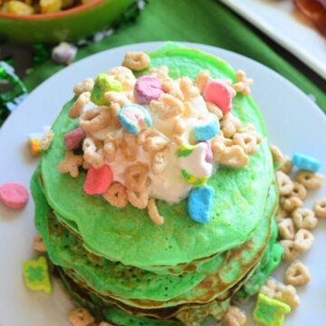 Top view of vertical photo of decorated St. Patrick's Day Lucky Charms Pancakes.