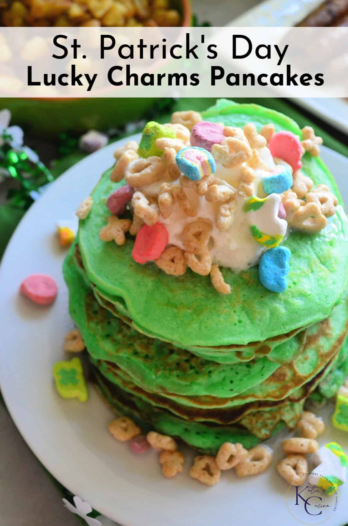 top view of stacked green pancakes topped with melted marshmallow and lucky charms with title text.