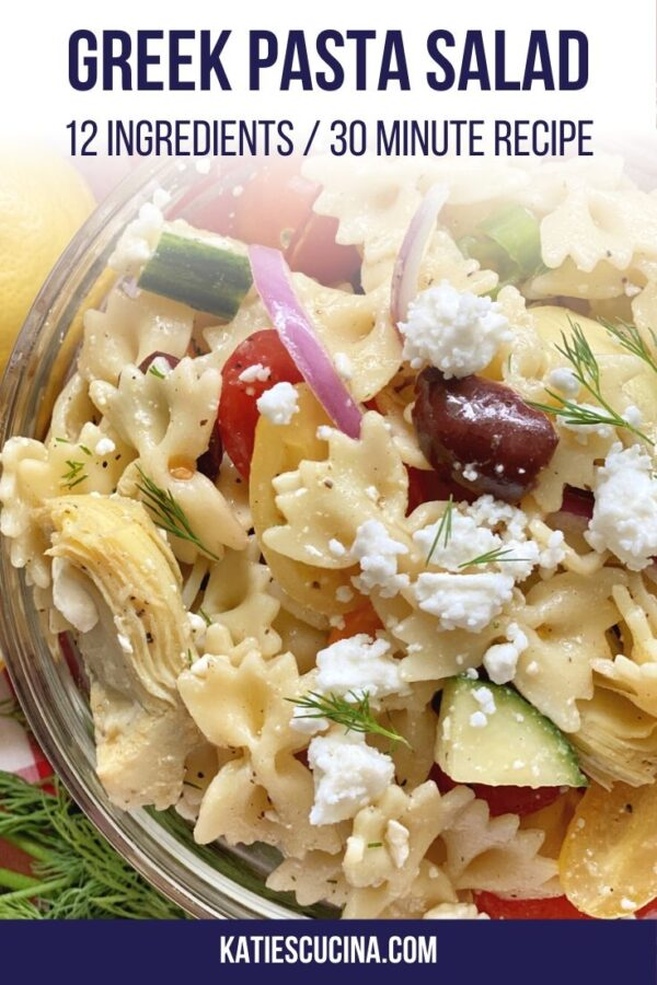 Vertical upclose photo of a bowl of pasta salad with feta cheese.