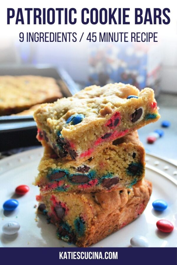 Stacked M&M cookie bars on a white plate with text for Pinterest.