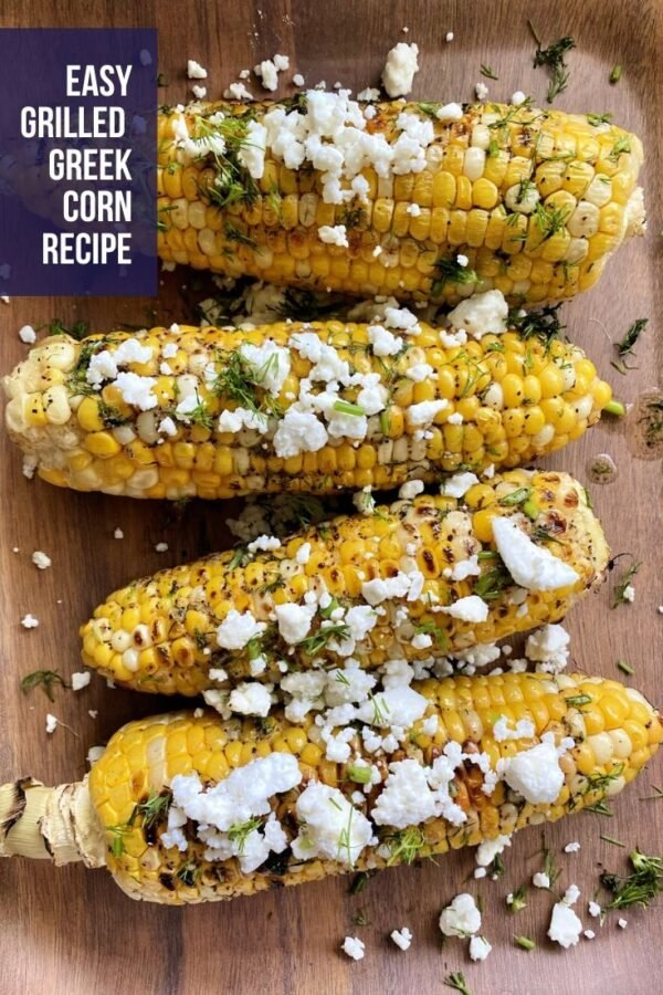 Top view of grilled corn with feta and fresh dill.