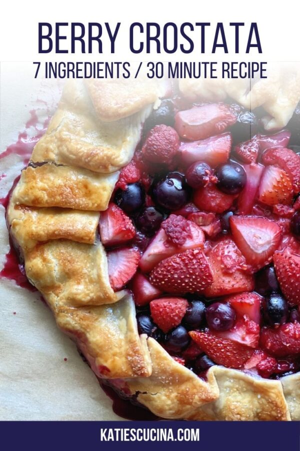 Top view of baked berry crostata with text for Pinterest.