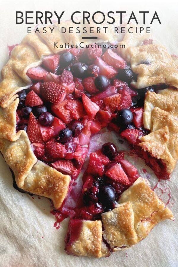 Top view of baked open pie with berries with text on image for Pinterest.