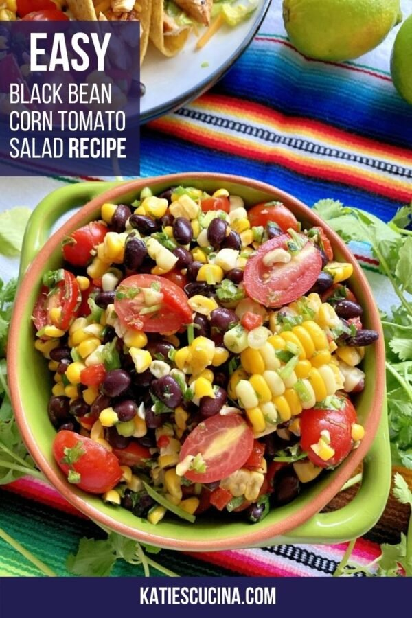 Top view of a green bowl with black beans, tomatoes, and corn with text on image for Pinterest.