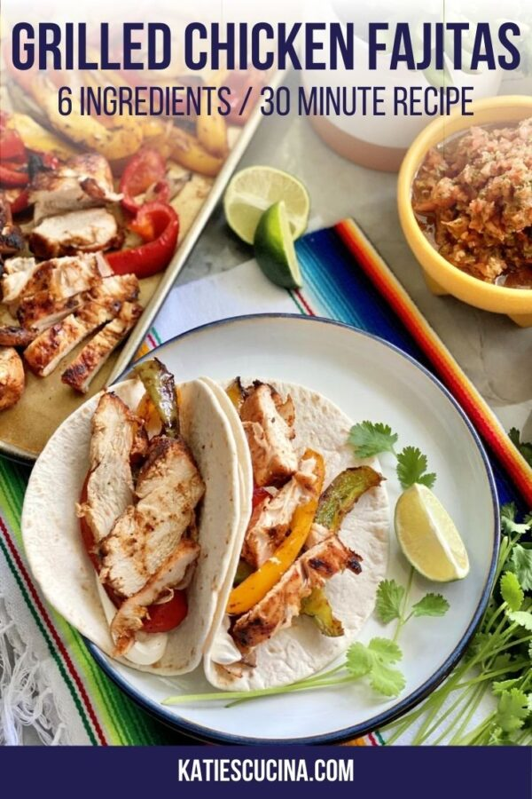 Overhead view of plated chicken fajitas in tortillas with lime with text on image.