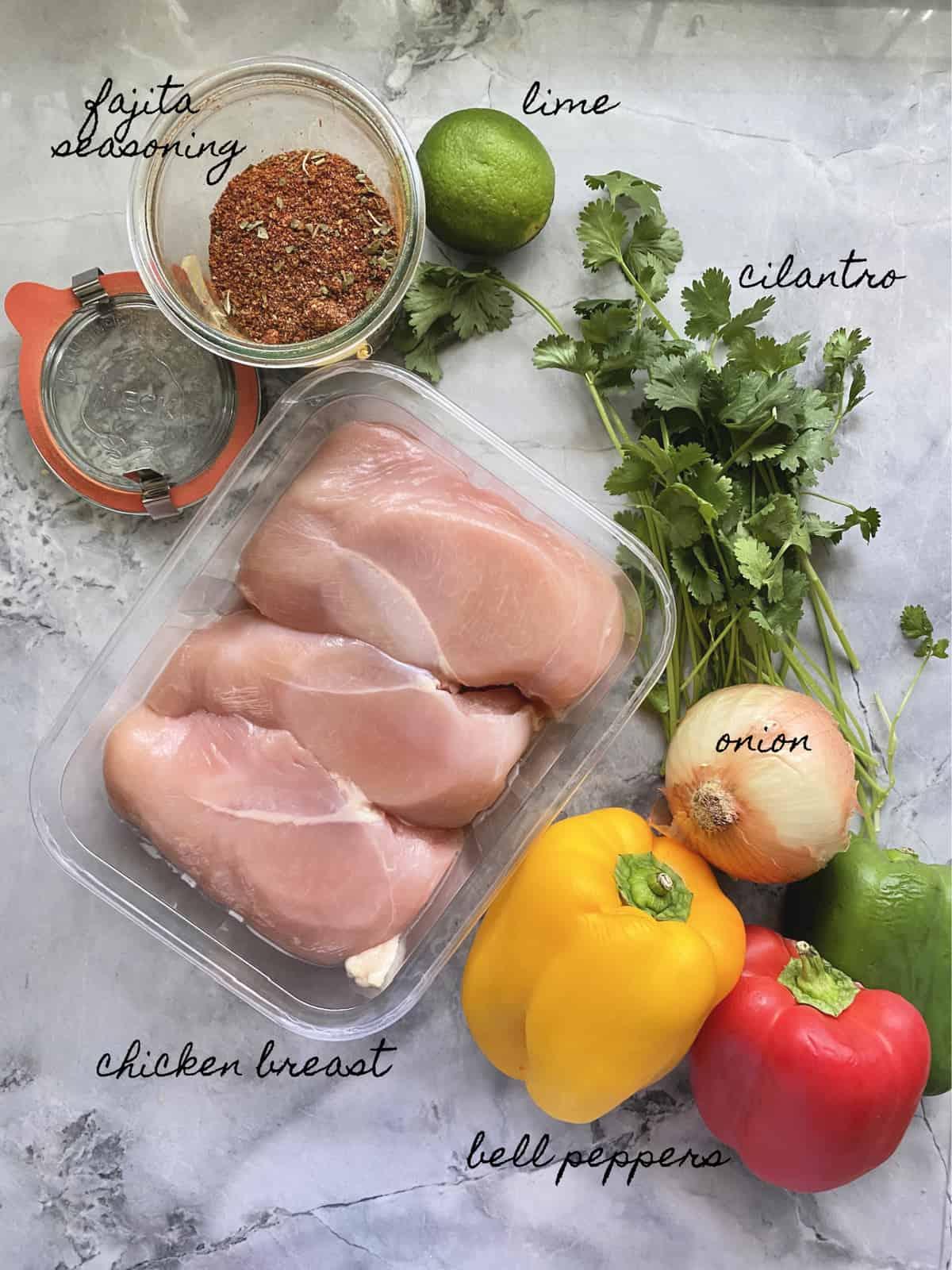 Ingredients: fajita seasoning, lime, cilantro, onion, chicken breast, and bell pepper.