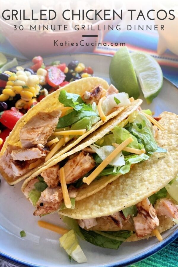 Three hard tacos with chopped chicken, lettuce, and cheese with text on image for Pinterest.