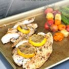 Gold baking sheet with cooked fish and veggies with text on image for Pinterest.
