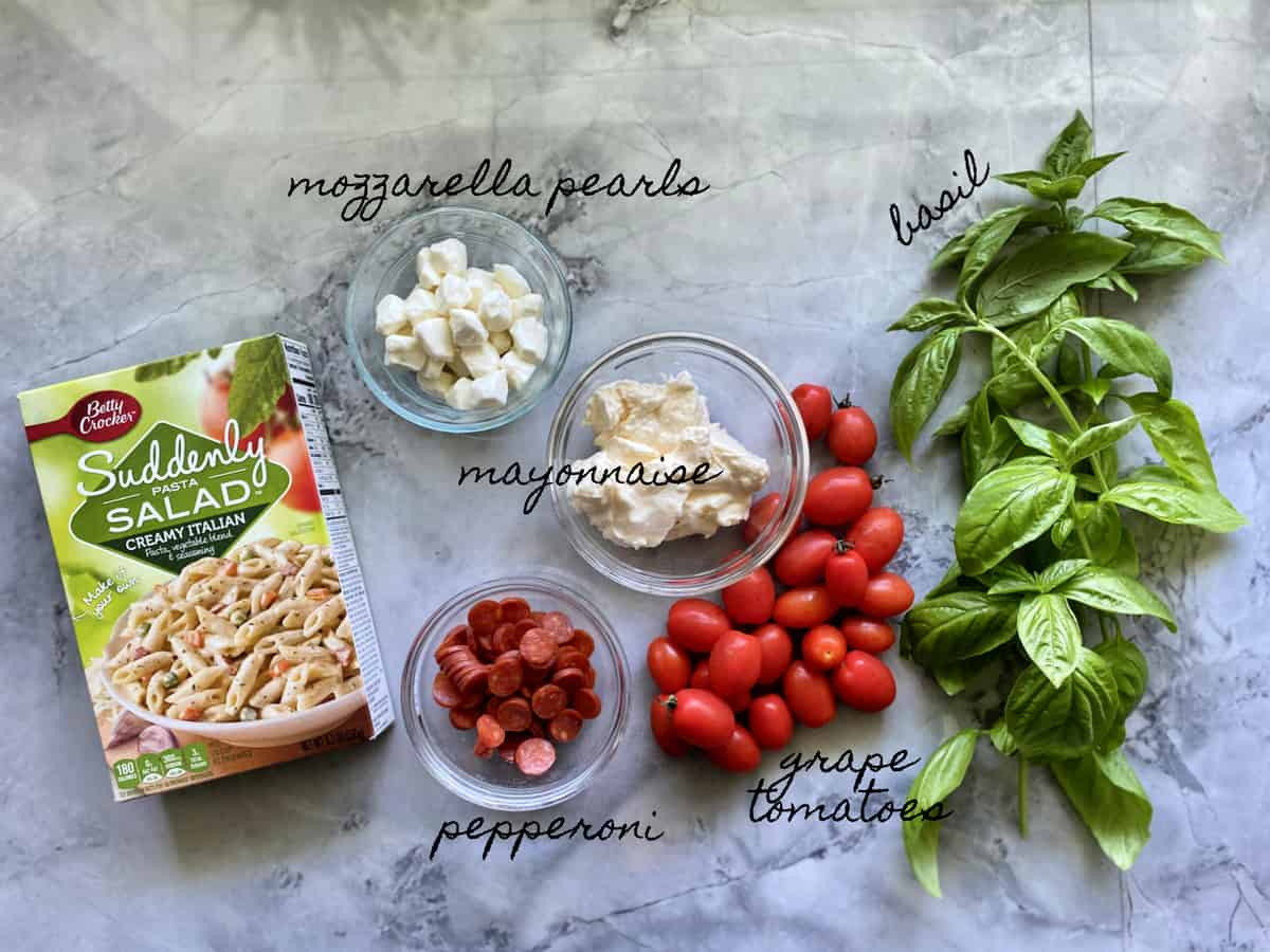 Ingredients: Suddenly Pasta Salad, mozzarella, mayonnaise, pepperoni, tomatoes, basil.