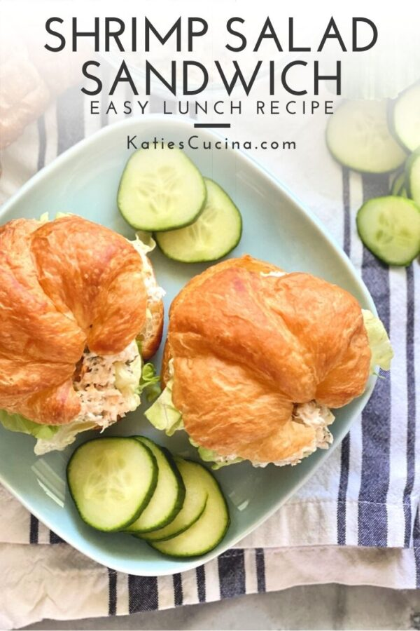 Top view of two croissants filled with shrimp salad sitting on a blue plate with text on image for Pinterest.