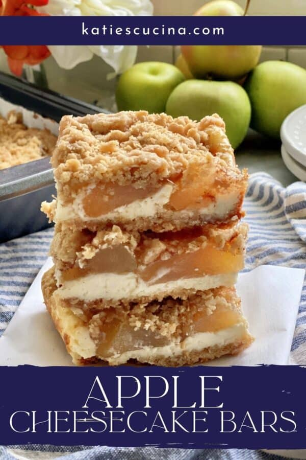 Three stacked apple cheesecake bars with crumb topping with text on image for Pinterest.