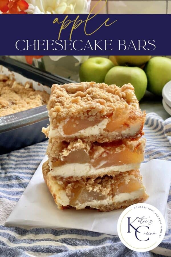 Three apple streusel cheesecake bars stacked on top of each other with text on image for Pinterest.