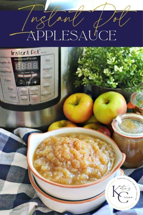 Applesauce in a white bowl with Instant Pot, apples, and jars in background.