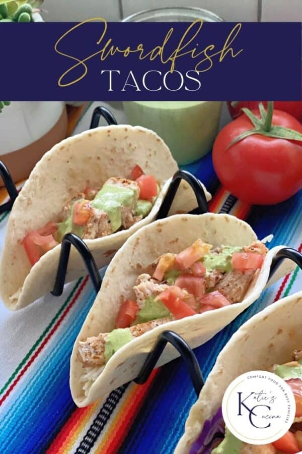 Two soft tacos on a black stand filled with fish with text on image for Pinterest.