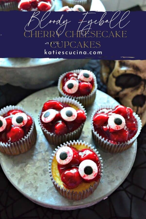 Cherry cheesecake cupcakes with candy eyeballs on them with text on image for Pinterest.