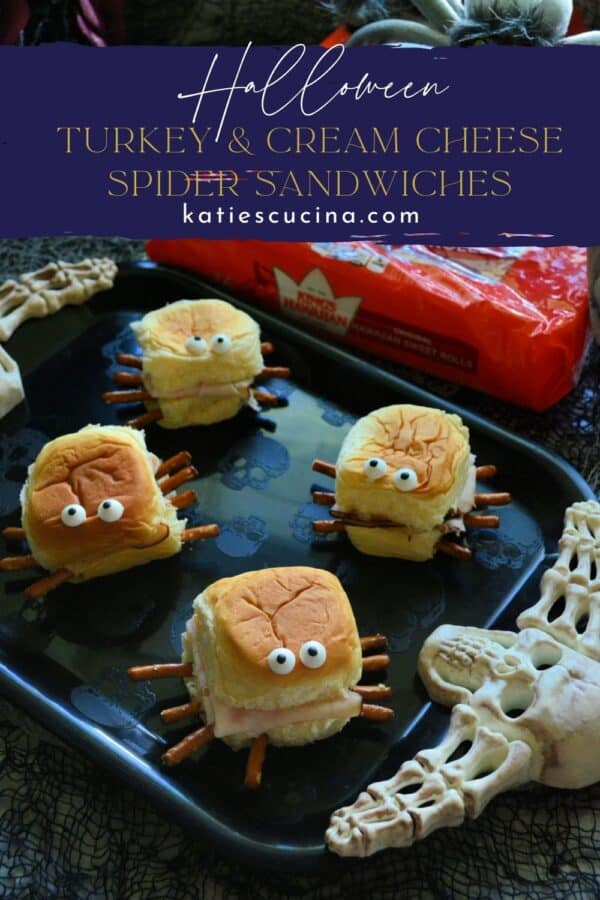 Four spider sandwiches on a black tray with text on image for Pinterest.