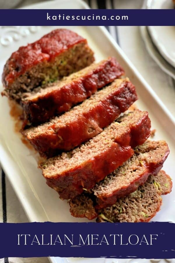 Top view of sliced meatloaf on a white platter with text on image for Pinterest.