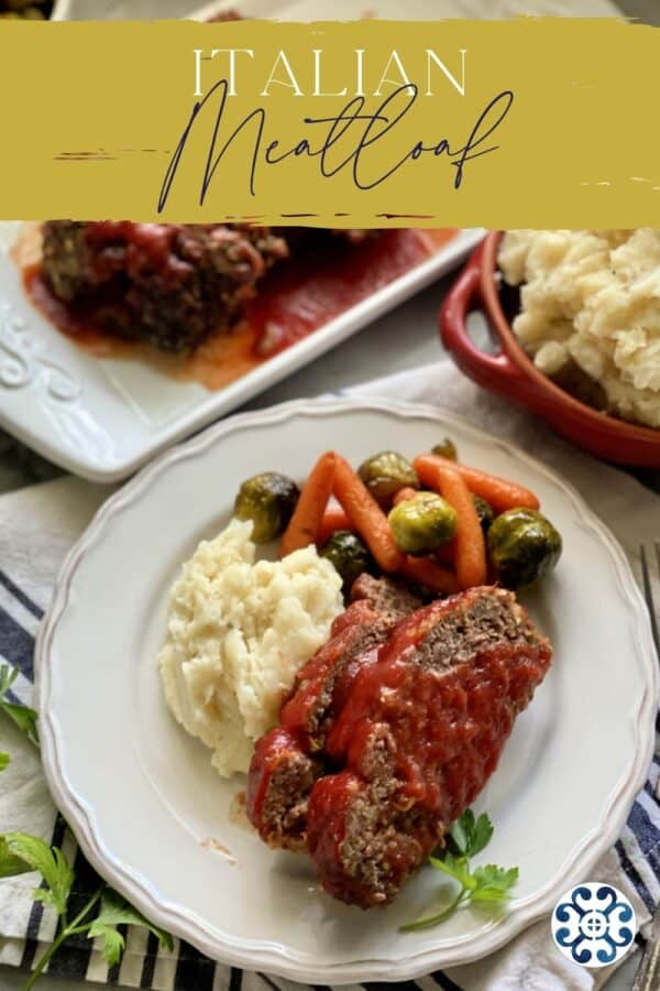 Top view of a meatloaf dinner on a white plate with text on image for Pinterest.