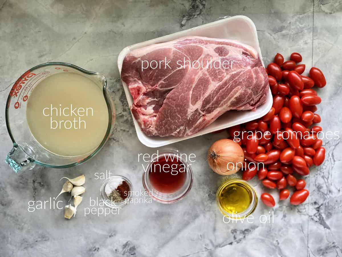 Ingredients: chicken broth, pork shoulder, tomatoes, onion, garlic, oil, seasonings.