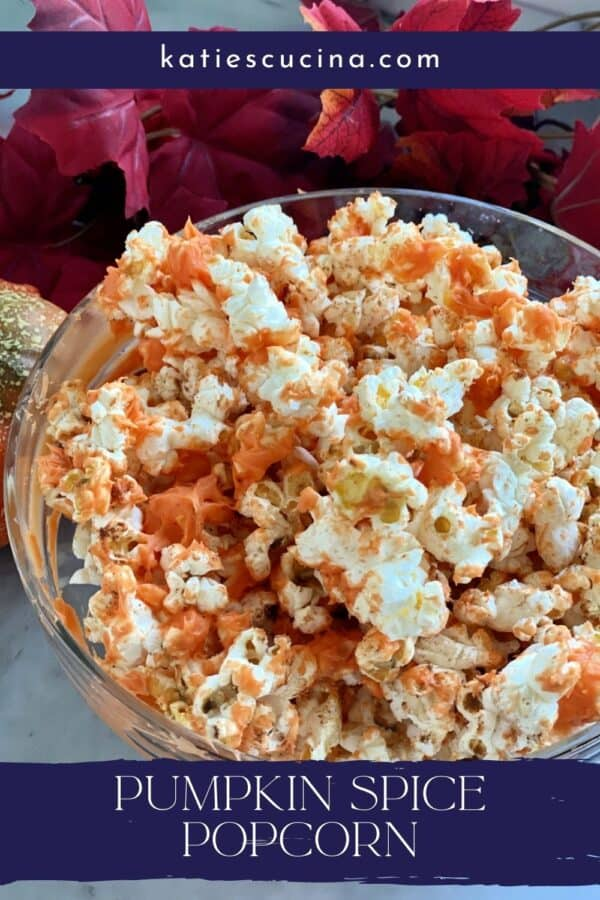 Top view of a bowl of orange popcorn with text on image for Pinterest.