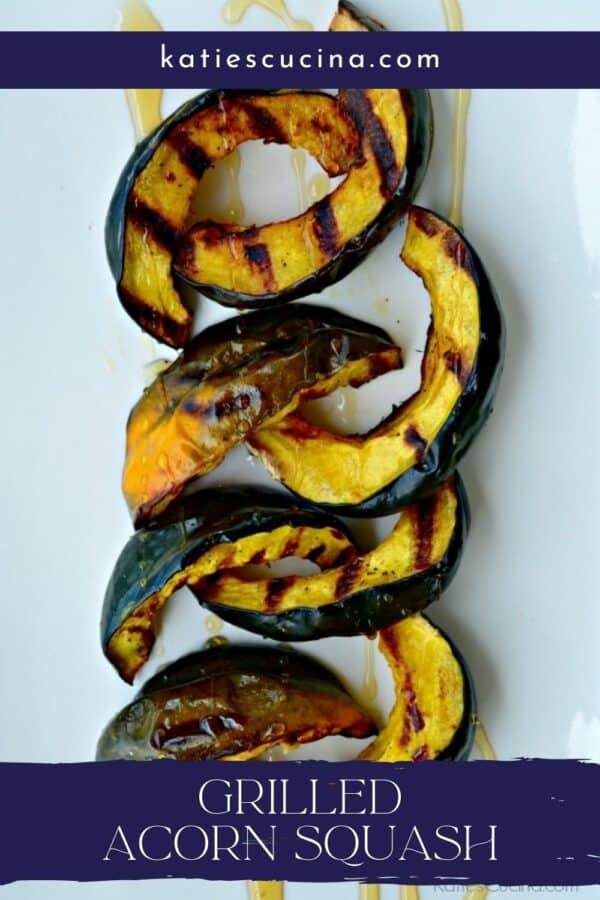 Top view of sliced acorn squash with text on image for Pinterest.