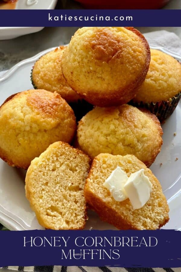 Top view of cornbread muffins, one sliced with butter on it with text on image for Pinterest.