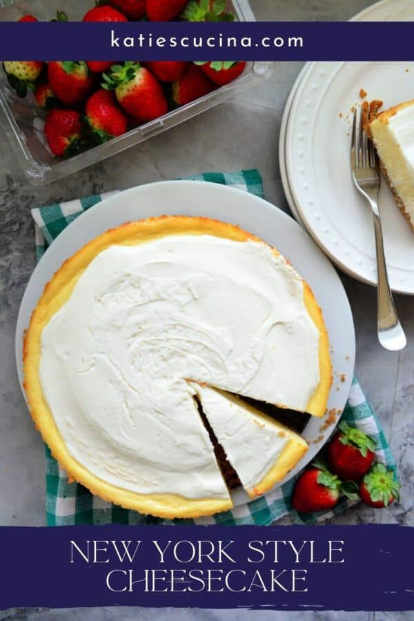 Top view of a whole cheesecake with a slice taken out and text on image for Pinterest.