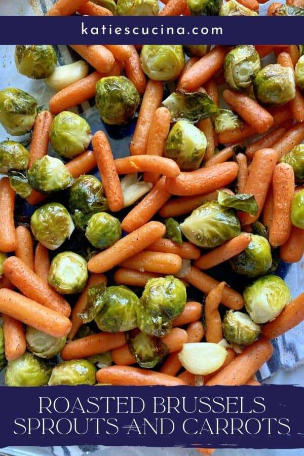 Top view of roasted carrots, brussels sprouts, and garlic with text on image for Pinterest.