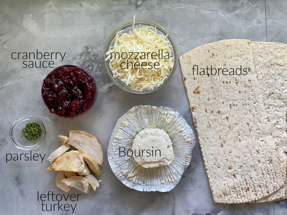 Ingredients: flatbreads, mozzarella, cranberry sauce, Boursin cheese, turkey, parsley.