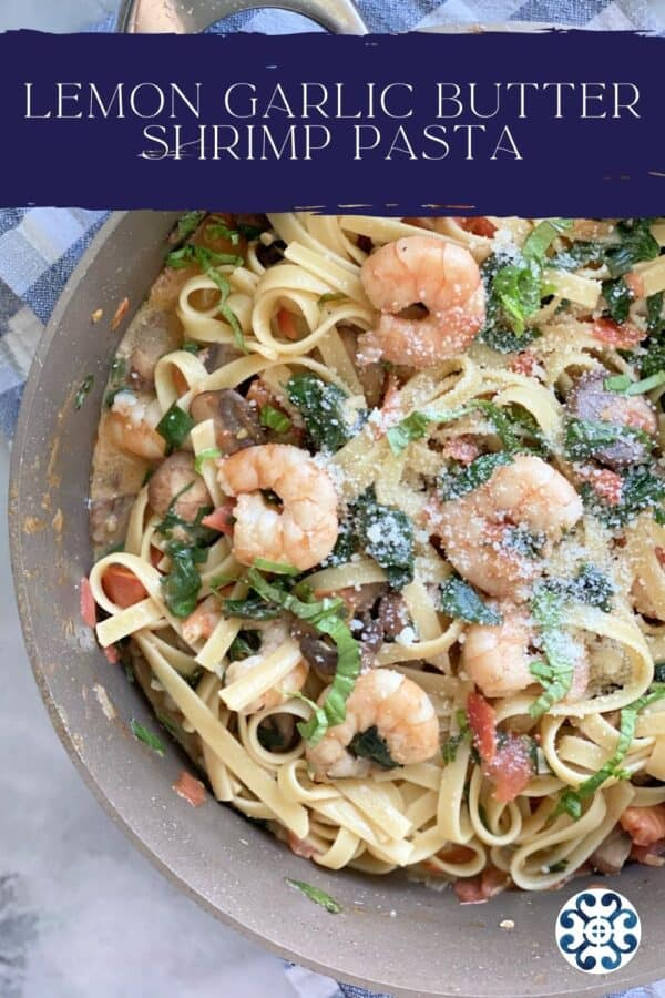 Top view of a skillet filled with Lemon Garlic Shrimp Pasta with text on image for Pinterest.