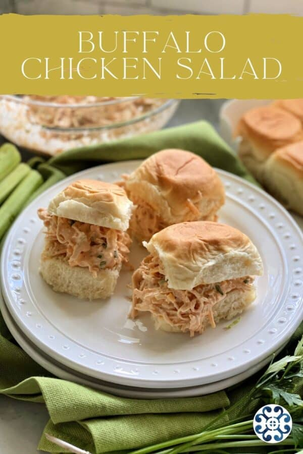 Three sandwiches filled with buffalo chicken salad on two white plates with text on image for Pinterest.