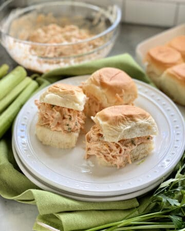 Three King's Hawaiian Rolls filled with shredded chicken on a white plate.