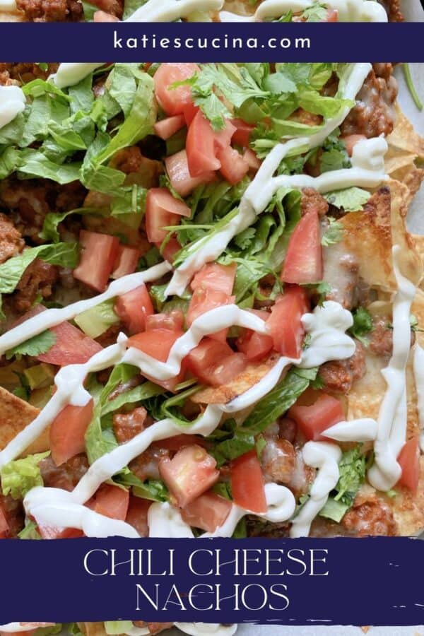 Close up of loaded chili cheese nachos with text on image for Pinterest.