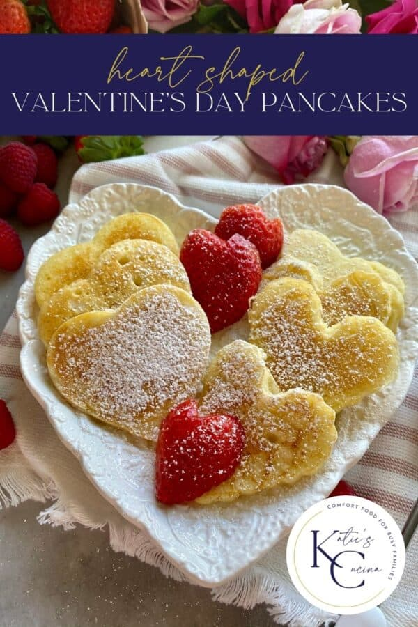 Heart shaped pancakes on a heart shaped plate with text on image for Pinterest.
