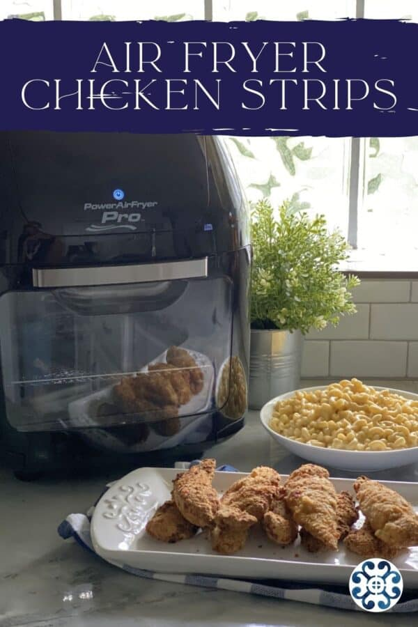 Chicken strips stacked with mac and cheese and air fryer in background with text on image for Pinterest.