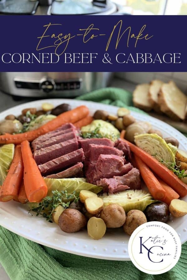 White platter filled with beef, cabbage, potatoes, and carrots with text on image for Pinterest.