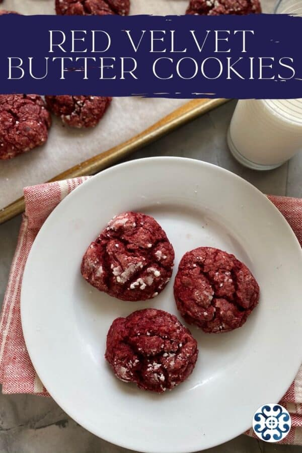 Top view of a three red cookies on a white plate with text on image for Pinterest.
