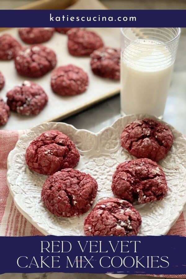White heart shaped plate with 5 red cookies with text on image for Pinterest.