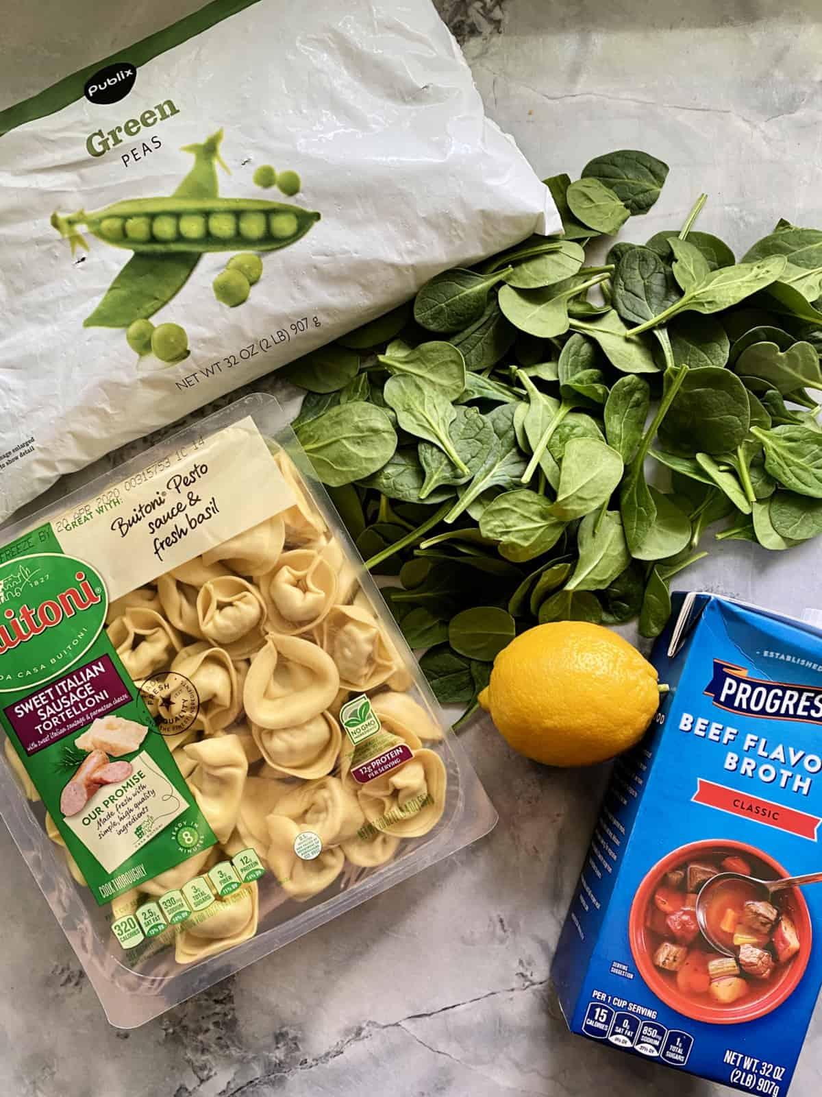 Ingredients: frozen peas, fresh spinach leaves, lemon, beef broth, sausage tortelloni