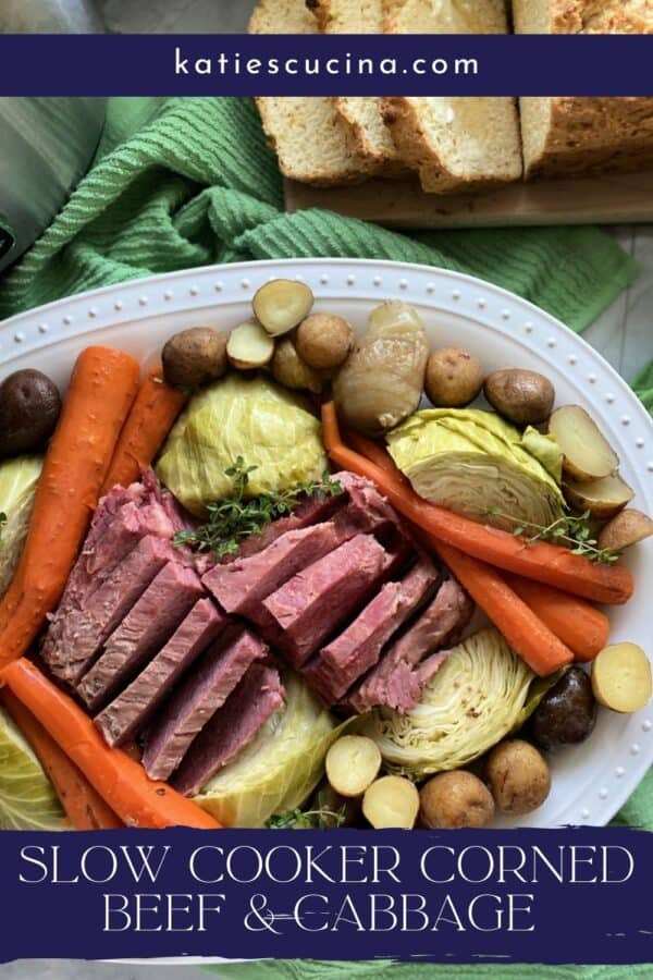 White platter filled with meat, cabbage, and potatoes with text on image for Pinterest.