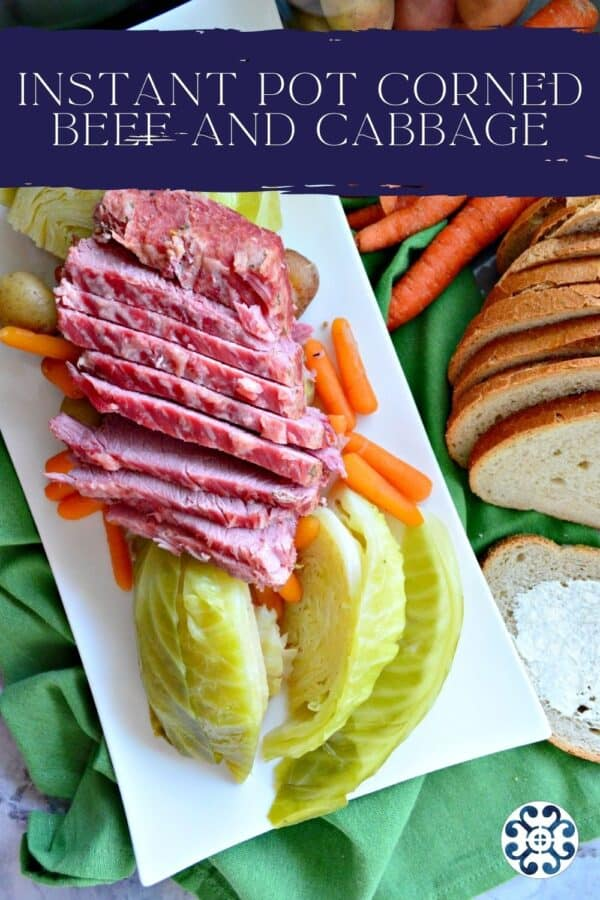 Top view of a white platter of corned beef, cabbage, carrots, and potatoes with text on image for Pinterest.
