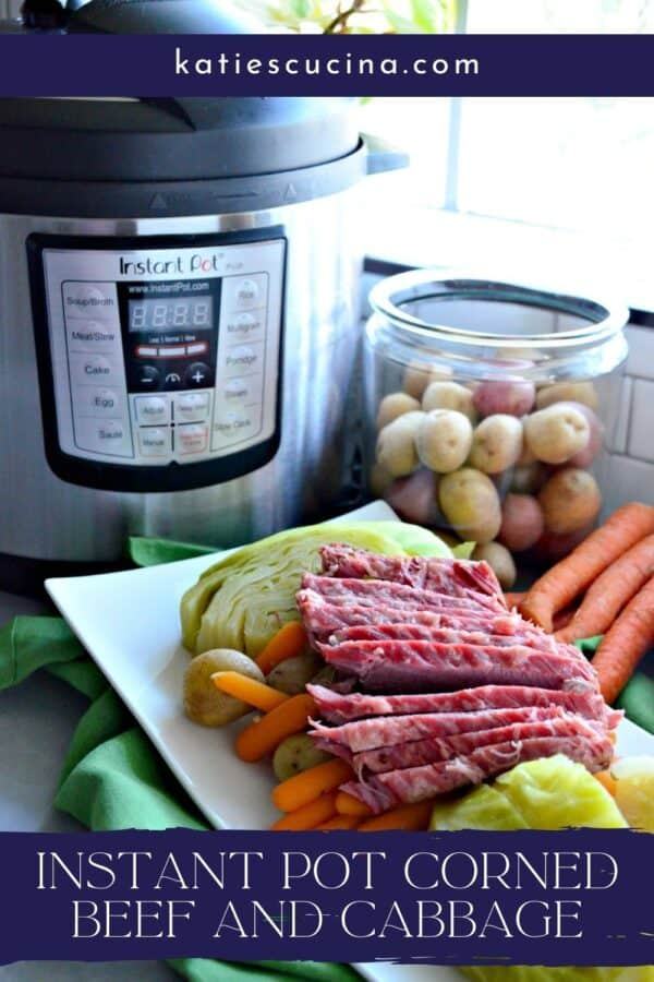 Corned beef and cabbage on a platter with an Instant Pot in the background with text on image for Pinterest.