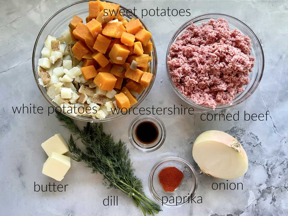 Ingredients; white potatoes, sweet potatoes, corned beef, worcestershire, butter, dill, paprika, and onion.
