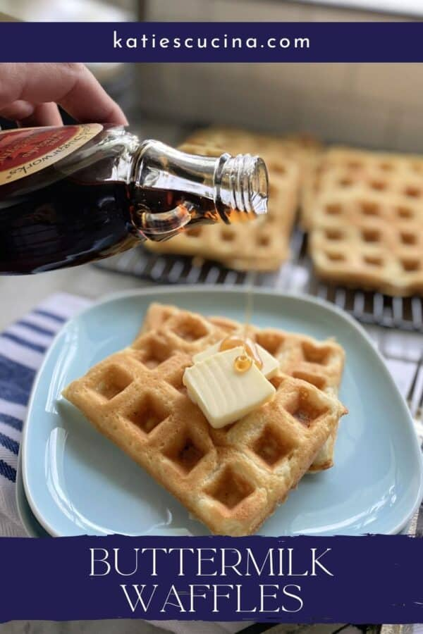 Hand pouring syrup onto waffles with recipe name on image for Pinterest.