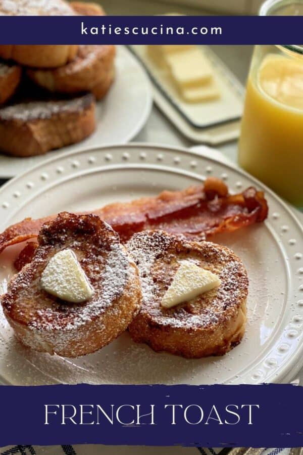 Two slices of french toast with butter and powder sugar on a white plate with recipe title on image for Pinterest.