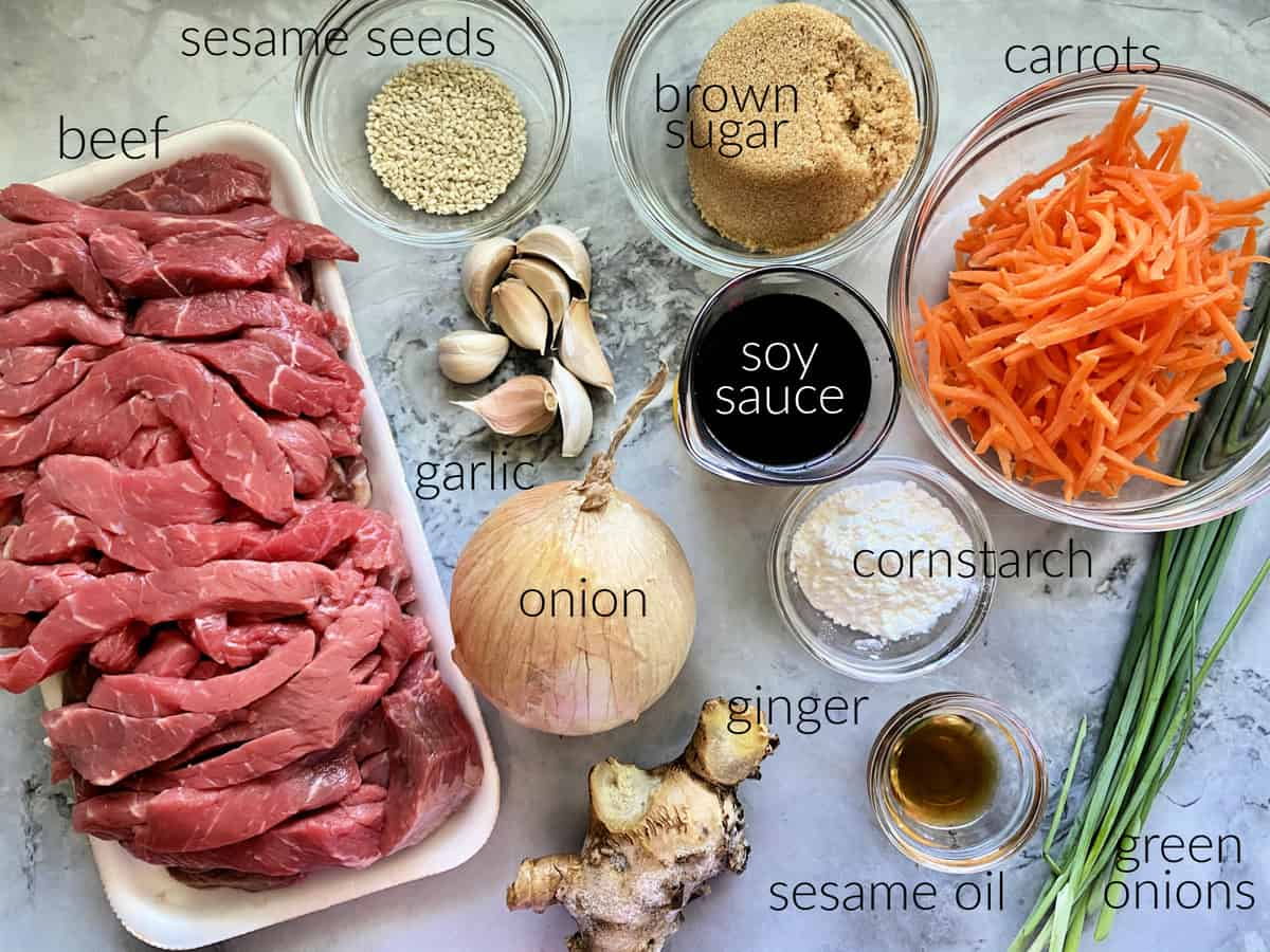 Ingredients: beef strips, sesame seeds, garlic, onion, soy sauce, brown sugar, ginger, sesame oil, green onions, carrots.